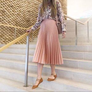 Pink Zara midi skirt with subtle metallic finish